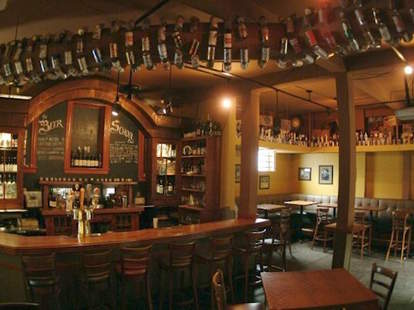 Sheffield's Beer and Wine Garden interior wood bottles chicago thrillist
