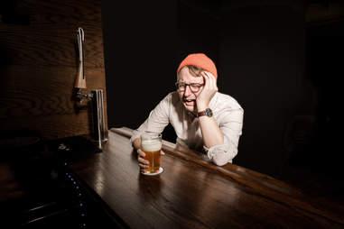 sad man at a bar