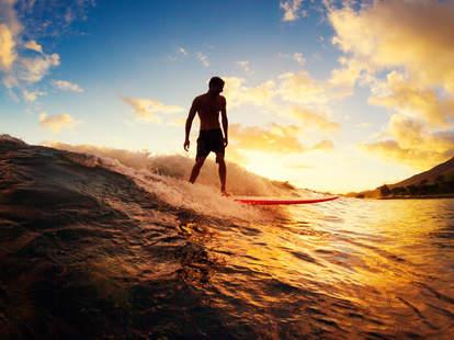 man surfing, surf board, surfing in the ocean