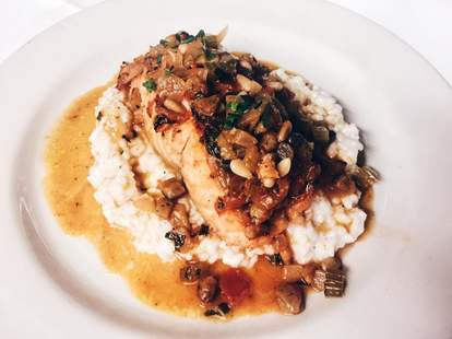 Italian Village- Chicago Salmon with eggplant, celery, tomatoes raisins capers basil pine nuts
