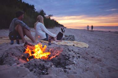 Hamptons beach bonfire couple and dog