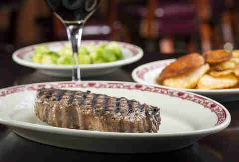 Gene and Georgetti's Restaurant, steak with wine and salad