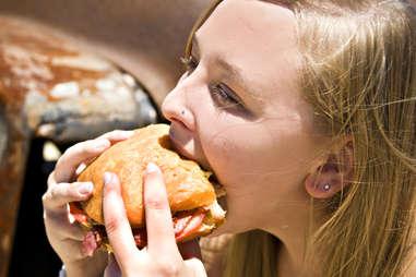 woman eating big burger
