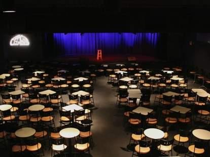 Cobb's Comedy Club interior tables blue curtain san francisco thrillist