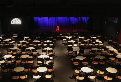 Cobb's Comedy Club interior tables blue curtain san francisco thrillist