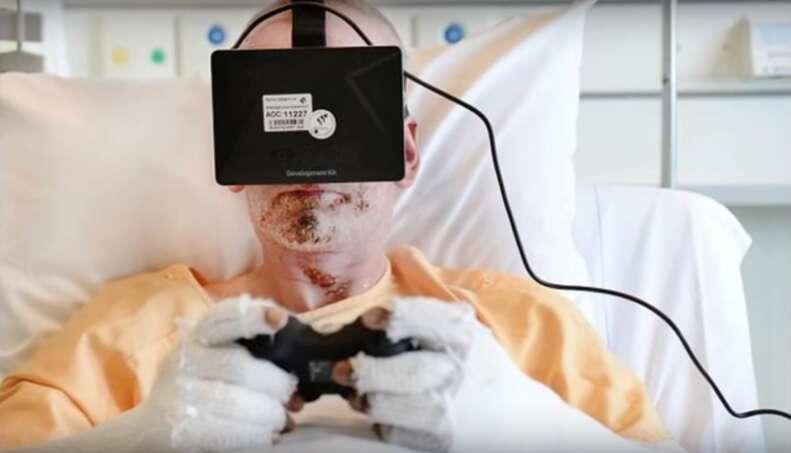 man in hospital bed wearing virtual reality headgear