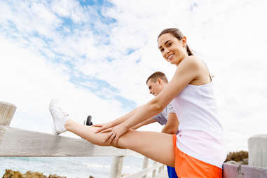 happy couple exercising together health benefits