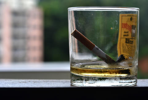 cigarette and whiskey glass thrililst