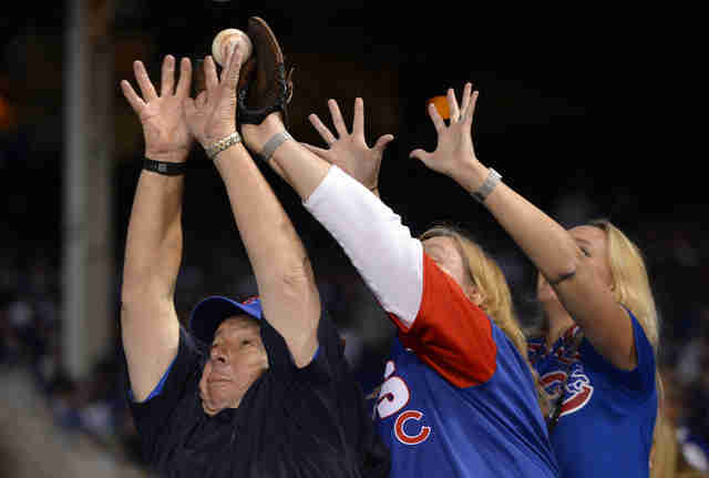 fans catching a foul ball, chicago cubs foul ball