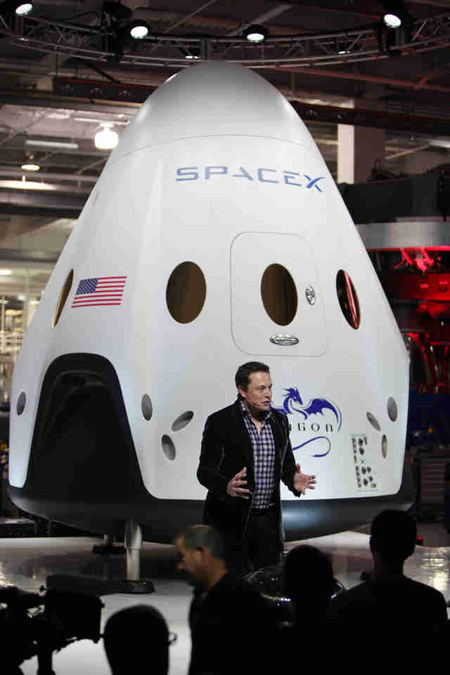 elon musk with dragon spacecraft