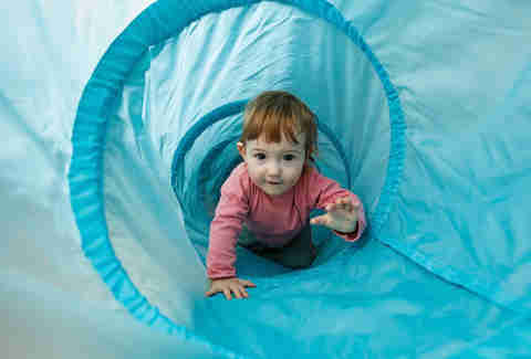 toddler in play area crawling
