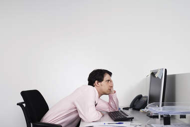 Business man slouched in front of computer