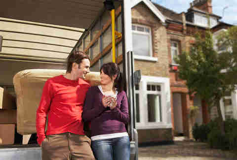 Couple in front of a new home