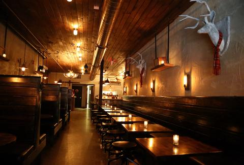 THE ARCHER interior dim lighting mounted deer heads thrillist