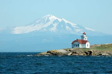 The Patos Island Lighthouse in front of Mt. Baker in Washington's San Juan Islands