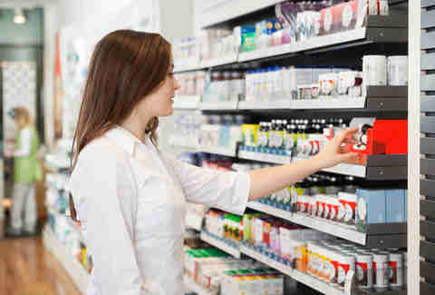 woman shopping for medicine pharmacy