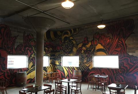 18TH STREET BREWERY interior painted walls tables thrillist