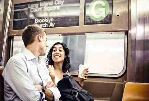 couple on subway in new york city nyc