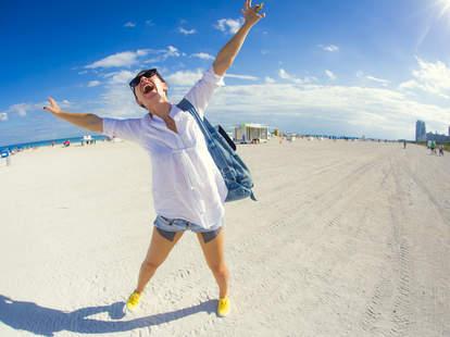 happy woman on beach in miami