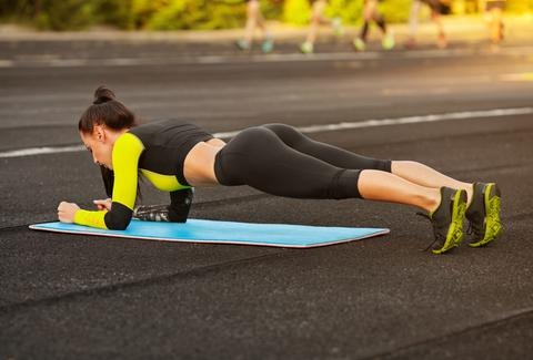 woman planking exercise floor exercises