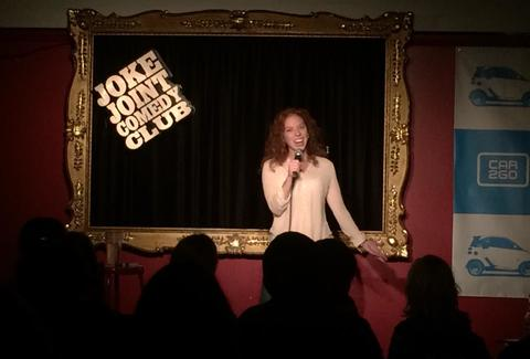 joke joint comedy club girl on stage