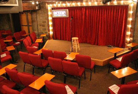 acme comedy club stage red seats thrillist