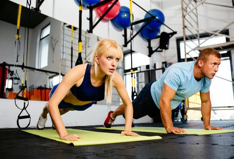 couple exercising floor exercises