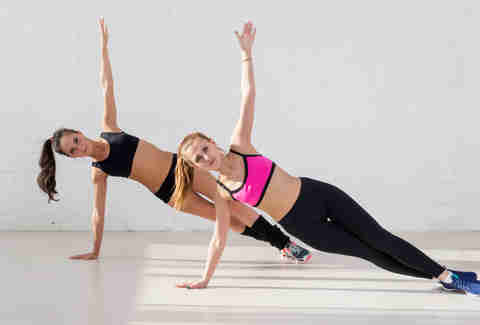 women exercising side plank
