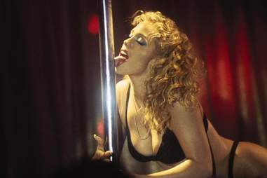 Elizabeth Berkley from Showgirls licking a pole