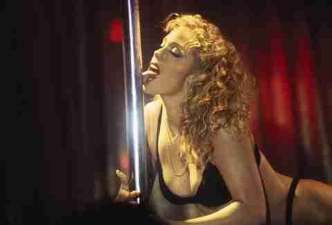 Elizabeth Berkley from Showgirls licking a pole