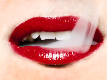 Red lipstick lips with smoke coming out