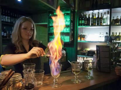Woman preparing absinthe