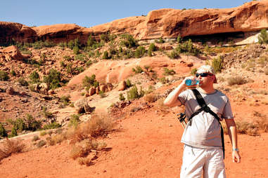 drinking water while hiking