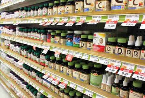 shelves of multivitamin bottles