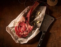 B&B Butchers & Restaurant steak and knife on counter Houston thrillist