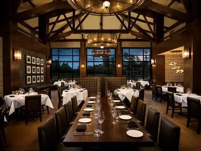Robard's Steakhouse interior dark wood long table room houston thrillist