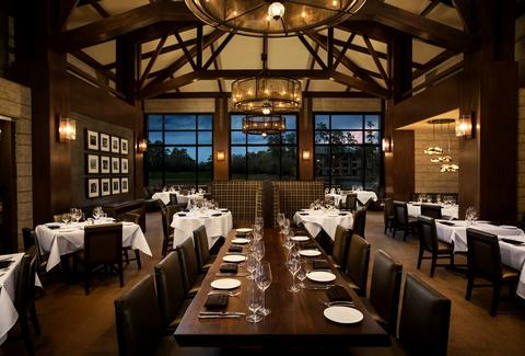 Robard's Steakhouse interior dark wood long table room houston thrillist