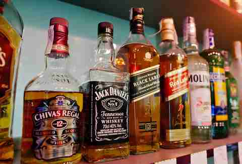 Bottle of Johnnie Walker's and Chivas Regal on a shelf