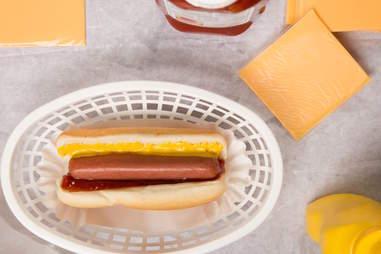 hot dog with mustard ketchup American cheese