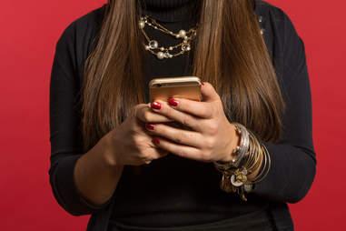 woman sending text