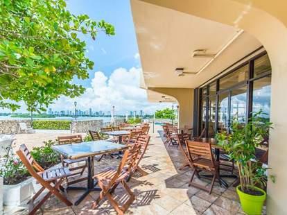 Full Bloom Gourmet Vegan Cuisine exterior deck patio tables blue sky thrillist miami
