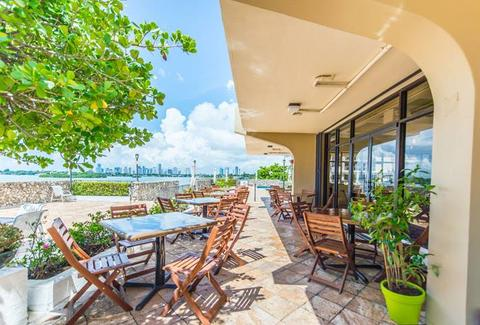 Full Bloom Gourmet Vegan Cuisine exterior deck patio tables blue sky thrillist miami
