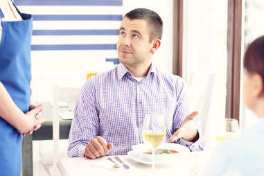 man unhappy with food at restaurant