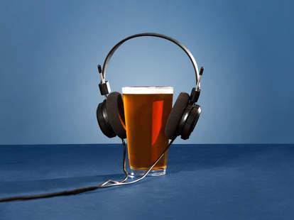 beer pint with headphones on