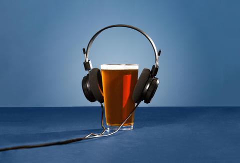 beer pint with headphones on
