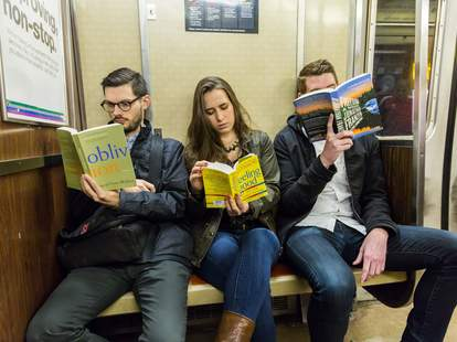 people reading on the subway