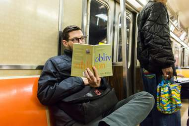 guy reading david foster wallace on subway