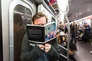 Guy reading Nietzsche on subway