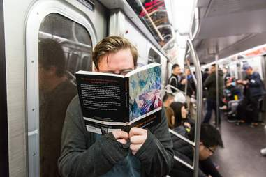 Guy reading Nietzsche on subway