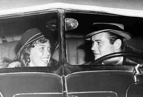 Vintage photo of couple sitting in car